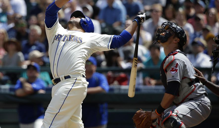 Seattle Mariners' Welington Castillo, left, pops out in foul territory to Cleveland Indians right fielder Brandon Moss as Indians catcher Yan Gomes, right, looks on in the fourth inning of a baseball game, Sunday, May 31, 2015, in Seattle. (AP Photo/Ted S. Warren)