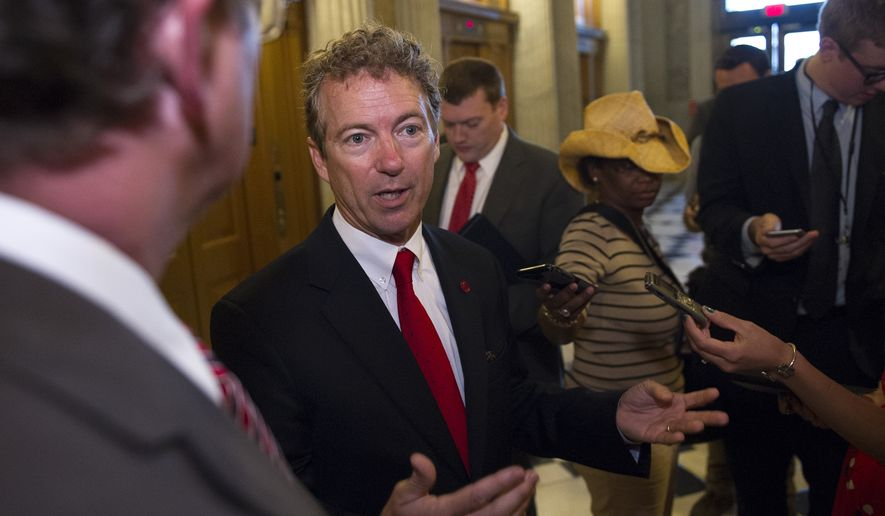 Sen. Rand Paul, R-Ky., talks with reporters outside of the Senate Chamber following his address to the Senate in Washington, Sunday, May 31, 2015. (AP Photo/Cliff Owen)