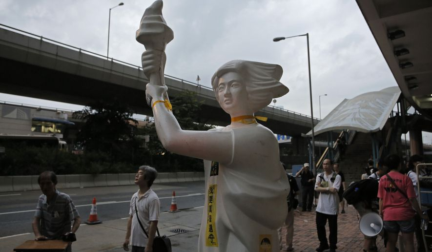 A statue of the Goddess of Democracy is displayed during a pro-democracy protest near the China Liaison Offices in Hong Kong Sunday, May 31, 2015. The protest marks the 26th anniversary of China's bloody crackdown on Tiananmen Square on June 4, ahead of a much larger annual candlelight vigil. (AP Photo/Vincent Yu)