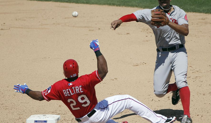 Texas Rangers' Adrian Beltre (29) slides into second as Boston Red Sox shortstop Xander Bogaerts throws to first during the fifth inning of a baseball game, Sunday, May 31, 2015, in Arlington, Texas. Beltre injured his left thumb on the play. (AP Photo/Brandon Wade)