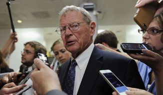 Sen. James Inhofe, R-Okla., chairman of the Senate Environment and Public Works Committee, speaks to reporters on Capitol Hill in Washington. in this 2014 file photo. (AP Photo/Susan Walsh) **FILE**