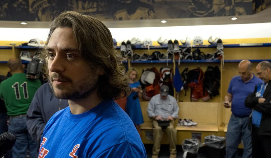 New York Rangers Mats Zuccarello listens to a question in the locker room at the team's Westchester training facility in Greenburgh, N.Y., Monday, June 1, 2015. Zuccarello could not speak for four days after being hit in the head by a shot in the opening round of the Stanley Cup playoffs and sustaining a small skull fracture and some bleeding. (AP Photo/Craig Ruttle)