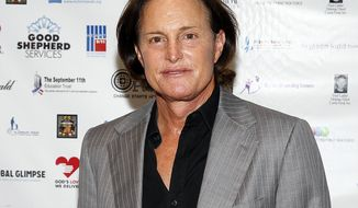 FILE - In this Sept. 11, 2013, file photo, former Olympic athlete Bruce Jenner arrives at the Annual Charity Day hosted by Cantor Fitzgerald and BGC Partners, in New York. Jenner made his debut as a transgender woman on the cover for the July 2015 issue of Vanity Fair. The image was shot by famed celeb photographer Annie Leibovitz. (Photo by Mark Von Holden/Invision/AP, File)