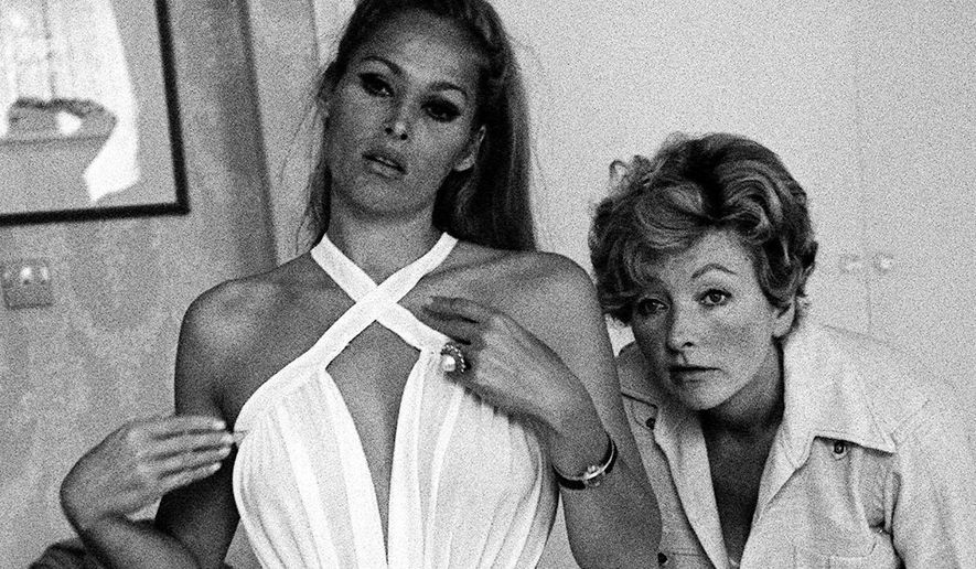 FILE - In this June 26, 1966 file photo, Oscar-winning British costume designer Julie Harris, right, watches actress Ursula Andress on the set of the James Bond film 'Casino Royale'.  Julie Harris, an Academy Award-winning costume designer who outfitted James Bond and The Beatles, had died aged 94. Friend Jo Botting, a British Film Institute curator, said Harris died Saturday, May 30, 2015 at a London hospital after suffering from a chest infection. (PA via AP, File) UNITED KINGDOM OUT