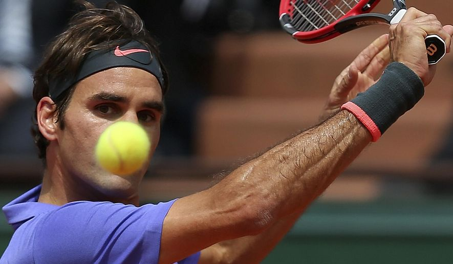Switzerland's Roger Federer eyes the ball as he plays France's Gael Monfils during their fourth round match of the French Open tennis tournament at the Roland Garros stadium, Monday, June 1, 2015 in Paris. Federer won 6-3, 4-6, 6-4, 6-1. (AP Photo/David Vincent)