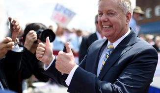Sen. Lindsey Graham, R-S.C. gives a thumbs-up as he greets supporters after announcing his bid for presidency, Monday, June 1, 2015, in Central, S.C. (AP Photo/Rainier Ehrhardt)