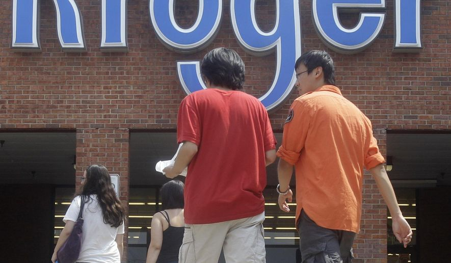 FILE - In this June 10, 2011 file photo, customers walk into a Kroger grocery store, in Cincinnati. Grocery giant Kroger Co. and Ohio officials on Monday, June 1, 2015 announced plans to bring nearly 650 jobs to new centers in Blue Ash, Ohio. (AP Photo/Al Behrman, File)