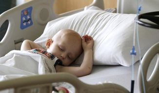 Landon Kimich, 2, sleeps as he receives a chemotherapy treatment for neuroblastoma at Houston's M.D. Anderson Cancer Center on Friday, May 22, 2015. The move to make cancer treatments gentler for children has paid a double dividend: More kids are surviving than ever before, and without the long-term complications that doomed many of their peers a generation ago, new research shows. (AP Photo/Pat Sullivan)