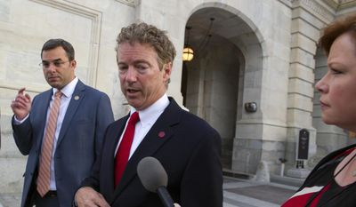 Sen. Rand Paul, R-Ky., talks with a reporter as he leaves the Capitol following his address to the Senate in Washington, Sunday, May 31, 2015. (AP Photo/Cliff Owen) ** FILE **