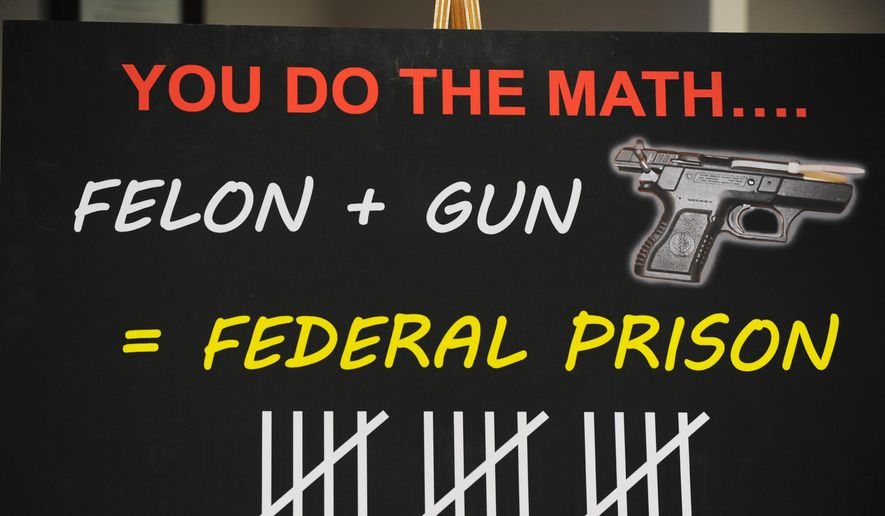 A rendering of billboards that will be put up around town warning criminals, who have three prior violent crime or drug convictions, that they will receive a 15 year mandatory federal prison sentence merely for possessing a gun is seen during a news conference at the US Attorney's Office in Detroit on Monday, June 1, 2015. The multi-pronged program uses a public awareness campaign, mandatory prison terms and federal prosecutions to reduce violent crime. (Brandy Baker/The Detroit News via AP) DETROIT FREE PRESS OUT; HUFFINGTON POST OUT; NO SALES; NO MAGS; NO ARCHIVE
