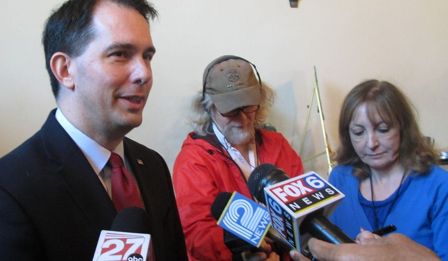 Gov. Scott Walker says he will sign a 20-week abortion ban regardless of whether there is an exemption for cases of rape or incest on Monday, June 1, 2015, in Delavan, Wis. (AP Photo/Scott Bauer)