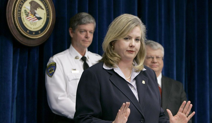 FILE - In this March 1, 2007, file photo, United States Attorney Catherine Hanaway, center, announces federal charges against Michael Devlin as Franklin County Sheriff Gary Toelke, left, and prosecuting attorney Bob Parks, right, listen in St. Louis. The Missouri Republican gubernatorial candidate Hanaway has support from South Carolina Gov. Nikki Haley. Haley, a Republican, is scheduled to speak June 18, 2015, at fundraiser for Hanaway at Hunter Farms in St. Louis. (AP Photo/Jeff Roberson, File)