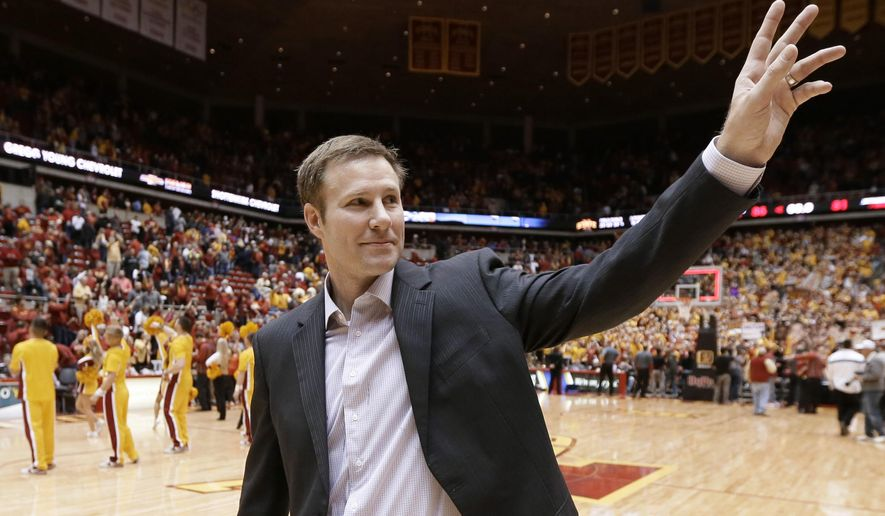 File- This Jan. 17, 2015, file photo shows Iowa State coach Fred Hoiberg waving to fans as he walks off the court after his team's NCAA college basketball game in Ames, Iowa. The Chicago Bulls plan to introduce Hoiberg as their new coach on Tuesday, June 2, 2015, a person familiar with the situation told The Associated Press. (AP Photo/Charlie Neibergall, File)