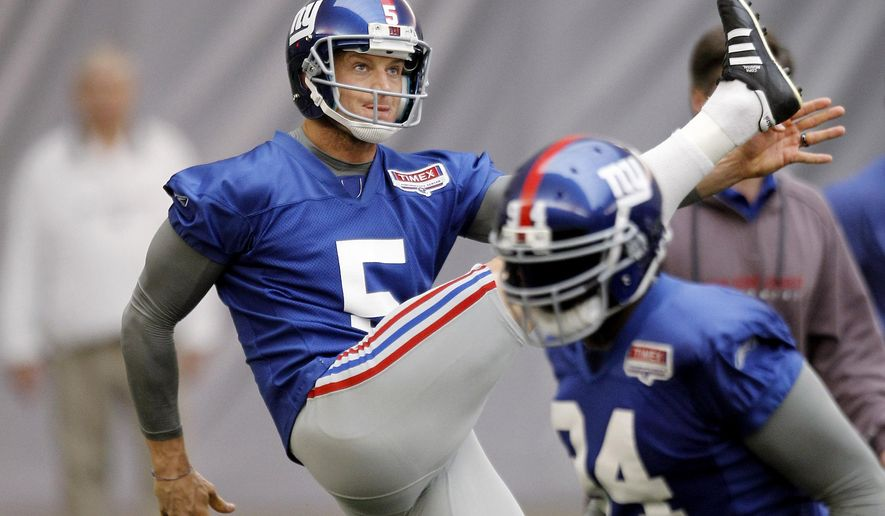 FILE - In a Feb. 2, 2012 file photo, New York Giants' Steve Weatherford (5) watches his punt during practice for the Super Bowl,, in Indianapolis. Weatherford said he's thankful for being unhurt early Monday, June 1, 2015, after totaling a rented car on the New Jersey Turnpike as he tried to return home for practice from visiting his newborn daughter in California. The punter was driving back to New Jersey from Washington because his San Diego-Newark flight was diverted because of thunderstorms. (AP Photo/Eric Gay, File)
