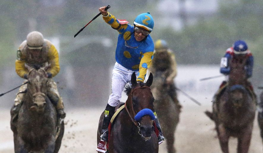 FILE - In this May 16, 2015, file photo, jockey Victor Espinoza, center, celebrates aboard American Pharoah after winning the 140th Preakness Stakes horse race at Pimlico Race Course in Baltimore. Last June, Espinoza was aboard California Chrome during his Triple Crown run that ended with a fourth-place finish in the Belmont. In 2002, he and trainer Bob Baffert teamed up with War Emblem to win the Kentucky Derby and Preakness before their Triple try ended when the colt stumbled out of the starting gate in the Belmont and finished eighth. Now, Espinoza and Baffert are back again with a colt many believed is poised to become the 12th Triple Crown winner and first since Affirmed in 1978. (AP Photo/Patrick Semansky, File)