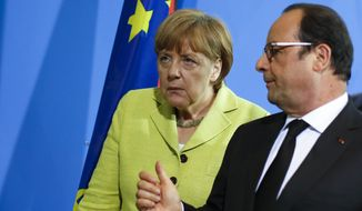 German Chancellor Angela Merkel, left, listens to the President of France Francois Hollande after a statement for the media prior to a meeting at the chancellery in Berlin, Germany, Monday, June 1, 2015. (AP Photo/Markus Schreiber)