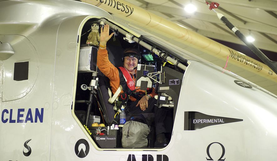 Swiss pilot Andre Borschberg waves from the aircraft Solar Impulse 2 before taking off at Nanjing Lukou International Airport in Nanjing in eastern China's Jiangsu province, in this Sunday, May 31, 2015, file photo. The solar plane attempting to fly around the world without a drop of fuel said Monday, June 1, that it is making an unscheduled stop in Nagoya, central Japan, because of bad weather. (Chinatopix via AP, File)