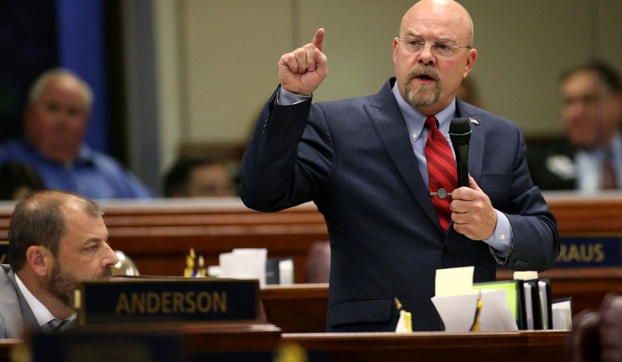 Nevada Assemblyman Ira Hansen, R-Sparks, speaks against Gov. Brian Sandoval's $1.1 billion tax plan during a passionate two-hour Assembly floor debate at the Legislative Building in Carson City, Nev., on Sunday, May 31, 2015. The Assembly approved the bill 30-10. (AP Photo/Cathleen Allison)