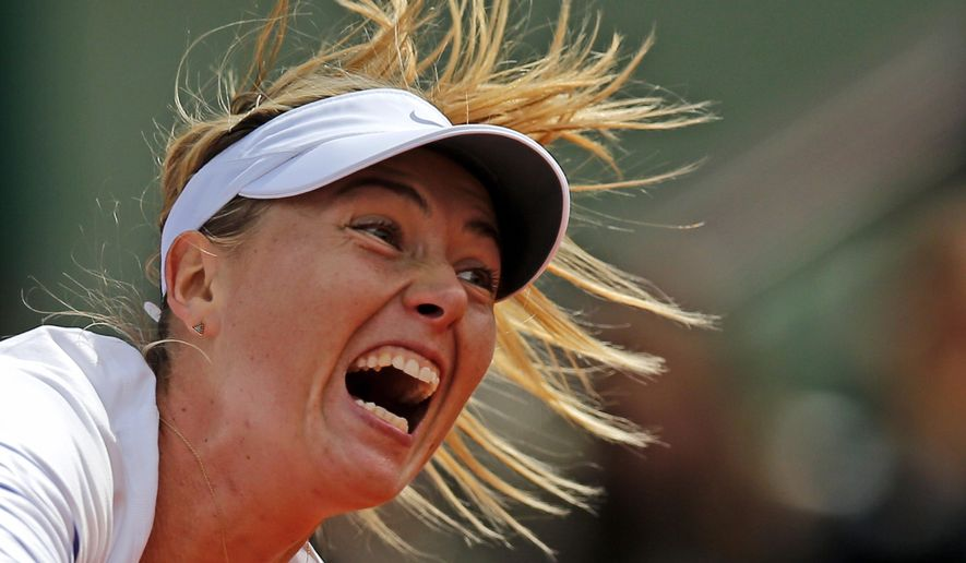 Russia's Maria Sharapova serves to Lucie Safarova of the Czech Republic during their fourth round match of the French Open tennis tournament at the Roland Garros stadium, Monday, June 1, 2015 in Paris, France. (AP Photo/Christophe Ena)
