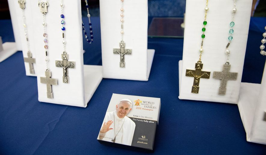 Merchandise for the scheduled World Meeting of Families Congress and Papal Visit is displayed during a news conference, Monday, June 1, 2015, in Philadelphia. Aramark has been named the official retail provider for event merchandise. (AP Photo/Matt Rourke)