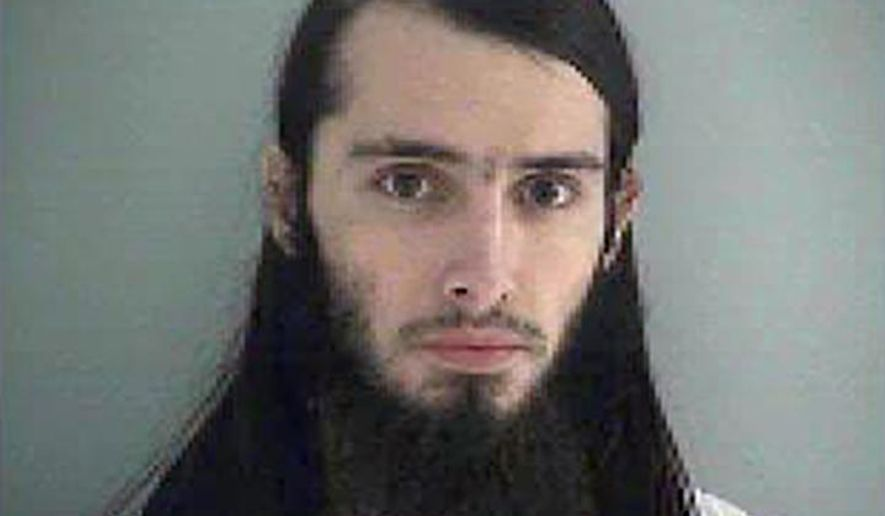 FILE - This undated file photo provided by the Butler County Jail shows Christopher Lee Cornell. A federal judge on Monday, June 1, 2015, again delayed court proceedings for Cornell accused of plotting to attack the U.S. Capitol in support of Islamic State extremists. (Butler County Jail via AP, File)
