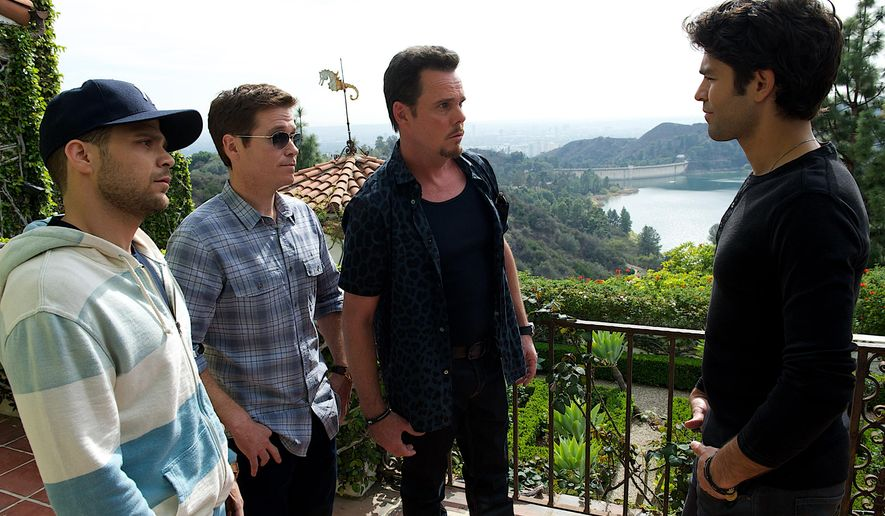 """HOLD FOR STORY - This photo provided by Warner Bros. Pictures shows, from left, Jerry Ferrara as Turtle, Kevin Connolly as Eric, Kevin Dillon as Johnny Drama and Adrian Grenier as Vince in Warner Bros. Pictures,' Home Box Office's and RatPac-Dune Entertainment's comedy """"Entourage,"""" a Warner Bros. Pictures release. (Claudette Barius/Warner Bros. Pictures via AP)"""
