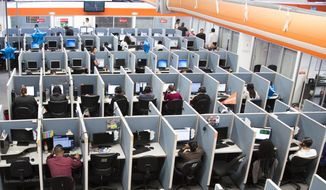 Office workers in a typical setting. (AP Photo/Alex Cossio, File)