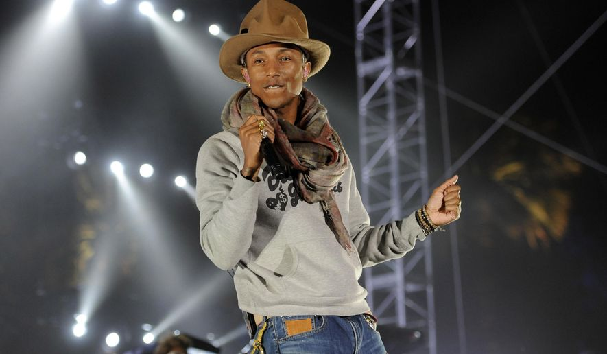FILE - In this April 12, 2014 file photo, Pharrell Williams performs at the 2014 Coachella Music and Arts Festival in Indio, Calif. Expect chic men's shorts and maybe even a tall hat: Pharrell is being honored by the fashion industry. The producer-singer-songwriter is this year's Fashion Icon at the annual Council of Fashion Designers of America awards, a glittery evening that brings a host of top fashion designers to New York's Lincoln Center along with celebrities like Kim Kardashian, who was scheduled to present one of Monday evening's awards. (Photo by Chris Pizzello/Invision/AP, File)