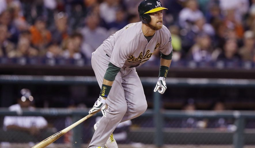 Oakland Athletics' Ben Zobrist watches as his grand slam clears the right field wall during the seventh inning of a baseball game against the Detroit Tigers, Tuesday, June 2, 2015, in Detroit. (AP Photo/Carlos Osorio)