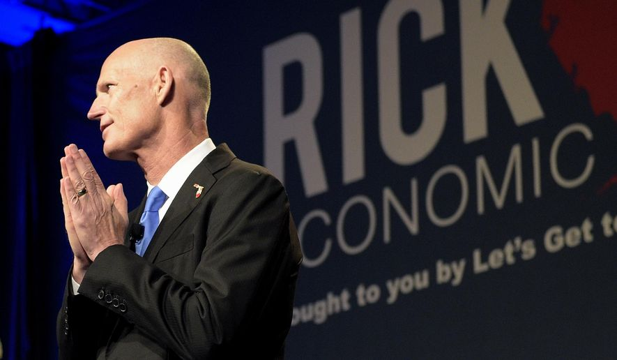 Florida Gov. Rick Scott gives the opening remarks during Rick Scott's Economic Growth Summit in Lake Buena Vista, Fla., Tuesday, June 2, 2015. (AP Photo/Phelan M. Ebenhack)