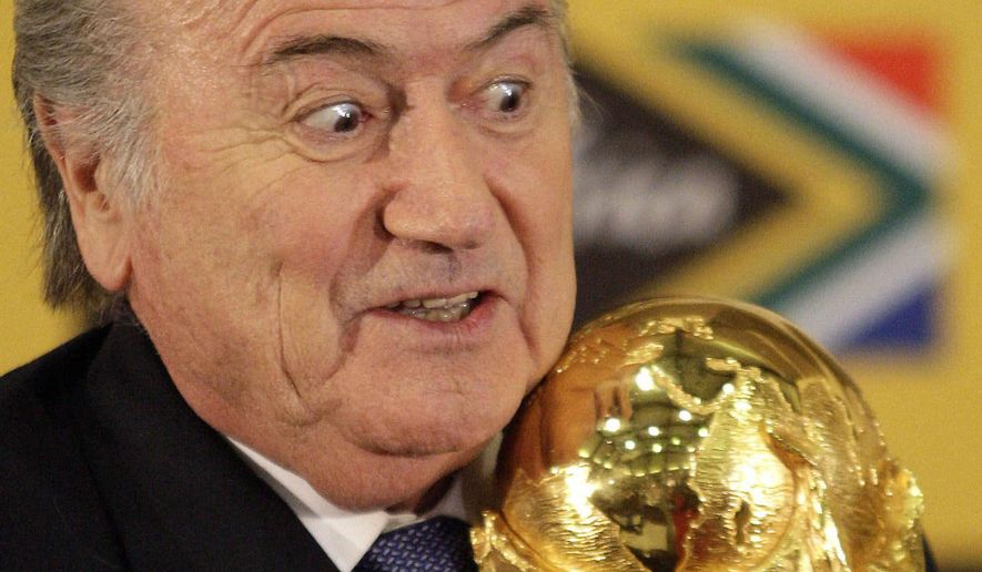 FILE - In this Sunday June 6, 2010 file photo FIFA President Joseph Blatter holds the trophy after receiving it back from South African President Jacob Zuma during a media briefing on the 2010 Soccer World Cup in Pretoria, South Africa.  FIFA President Sepp Blatter will resign from soccer's governing body amid a widening corruption scandal and promised Tuesday to call for fresh elections to choose a successor. (AP Photo/Themba Hadebe, File)