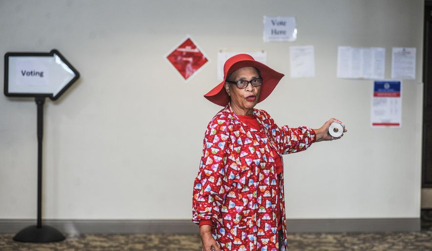 Poll worker Queenie Barnes directs voters to the polls at the Oxford Conference Center during a special election for Mississippi's 1st Congressional District, in Oxford, Miss. on Tuesday, June 2, 2015. Democrat Walter Zinn Jr. and Republican Trent Kelly  are vying for the seat previously held by Alan Nunnelee, who died in February 2015.  (Bruce Newman/Oxford Eagle via AP) NO SALES