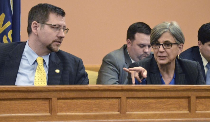 Kansas Senate Majority Leader Terry Bruce, left, R-Nickerson, listens as Senate President Susan Wagle, right, R-Wichita, makes a point during a discussion among GOP senators about tax issues, Tuesday, June 2, 2015, at the Statehouse in Topeka, Kan. Despite sharp disagreements among GOP legislators on tax issues, there's widespread support for a proposal to eliminate most state income tax deductions. (AP Photo/Nicholas Clayton)