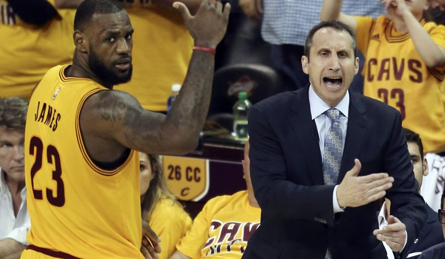 FILE - In this May 24, 2015, file photo, Cleveland Cavaliers head coach David Blatt yells at his team as LeBron James (23) looks on during overtime of Game 3 of the Eastern Conference finals of the NBA basketball playoffs against the Atlanta Hawks in Cleveland. Blatt was handed a star-studded team expected to win an NBA title, but not a handbook on how to get the Cavaliers to the top. For Blatt, who left his family in Israel to pursue his dream, the journey has been difficult with speculation about his future partly undermining his success. (AP Photo/Ron Schwane, File)