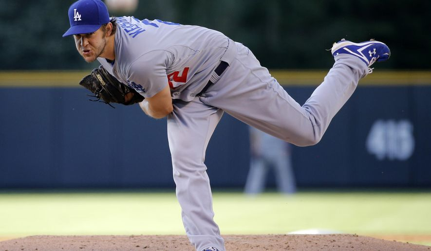 Los Angeles Dodgers starting pitcher Clayton Kershaw throws against the Colorado Rockies during the first inning of a baseball game Monday, June 1, 2015, in Denver. (AP Photo/Jack Dempsey)