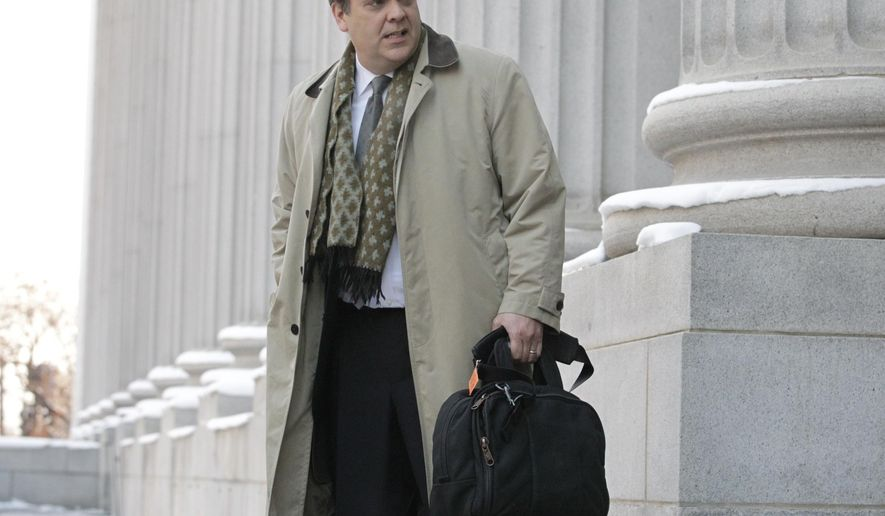 "FILE - In this Jan. 17, 2013, file photo, Jonathan Turley, attorney for Kody Brown and his four wives, the stars of the reality show ""Sister Wives,"" leaves the Frank E. Moss United States Courthouse, in Salt Lake City. State attorneys defending Utah's anti-polygamy law say it should stay on the books because it helps prevent abuse of women and children. The Utah Attorney General's Office laid out the argument in new court documents appealing a ruling in favor of reality show star Kody Brown that struck down key parts of the law. (AP Photo/Rick Bowmer, File)"