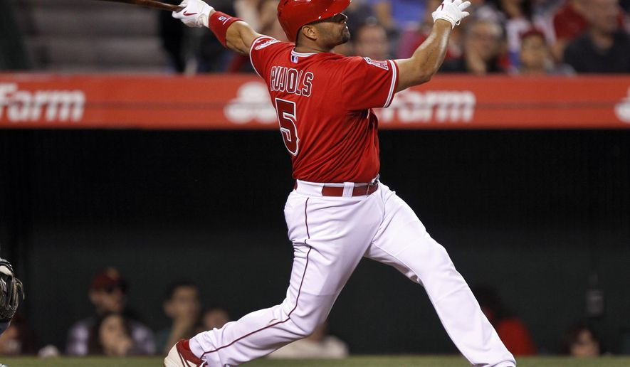 Los Angeles Angels' Albert Pujols hits a solo home run against the Tampa Bay Rays during the fifth inning of a baseball game in Anaheim, Calif., Monday, June 1, 2015. (AP Photo/Alex Gallardo)