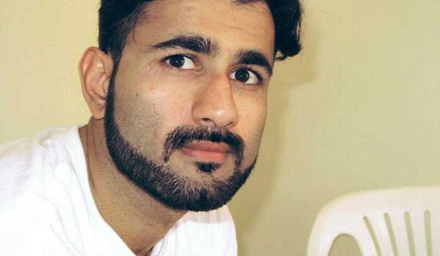 This Sept. 2009 photo, courtesy of the Center for Constitutional Rights, shows Majid Khan while imprisoned at the U.S. Navy base at Guantanamo Bay in Cuba. Khan, a former Maryland resident, was subjected to more incidents of mistreatment while in CIA custody than previously disclosed, according to the Center for Constitutional Rights, a New York legal organization that represents him and other prisoners. The center says he was twice subjected to the simulated drowning technique known as waterboarding, sexually assaulted, hung on a wooden beam and kept in darkness for a year in secret CIA captivity overseas. (Center for Constitutional Rights via AP)