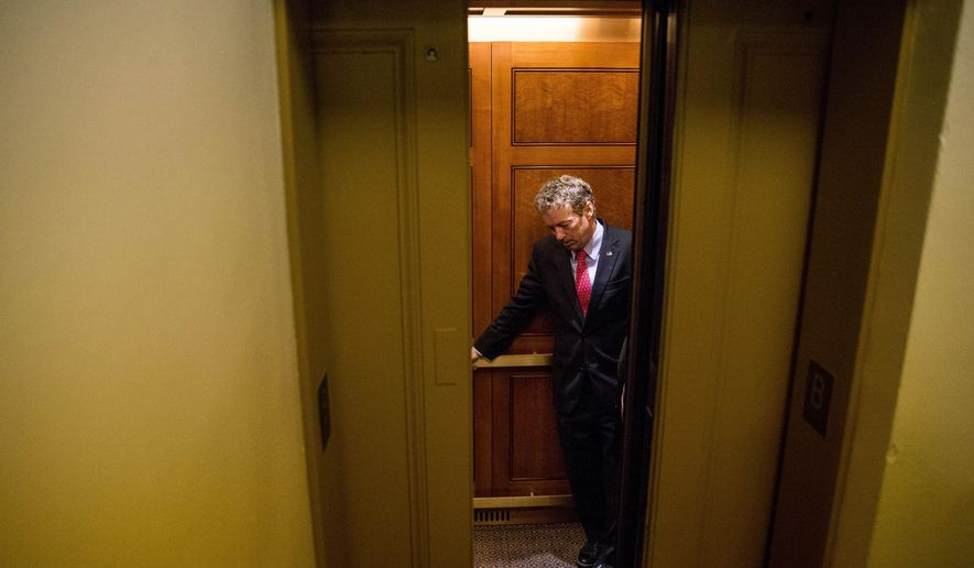Republican presidential candidate, Sen. Rand Paul, R-Ky. departs in an elevator after speaking at a news conference on Capitol Hill in Washington, Tuesday, June 2, 2015, calling for the 28 classified pages of the 9-11 report to be declassified. Paul has been voicing his dissent in the Senate against a House bill backed by the president that would end the National Security Agency's collection of American calling records while preserving other surveillance authorities. (AP Photo/Andrew Harnik)