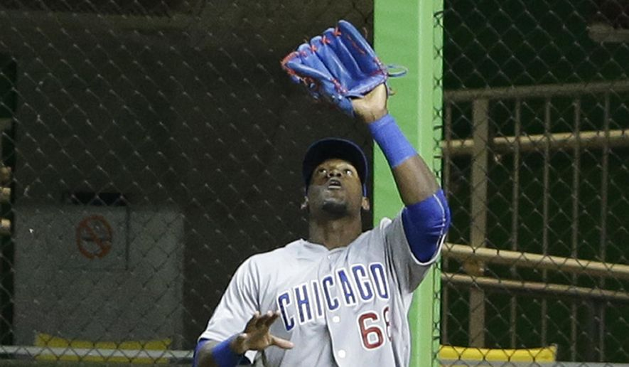 Chicago Cubs right fielder Jorge Soler catches a ball hit by Miami Marlins' Marcell Ozuna during the ninth inning of a baseball game, Monday, June 1, 2015, in Miami. The Cubs defeated the Marlins 5-1. (AP Photo/Wilfredo Lee)