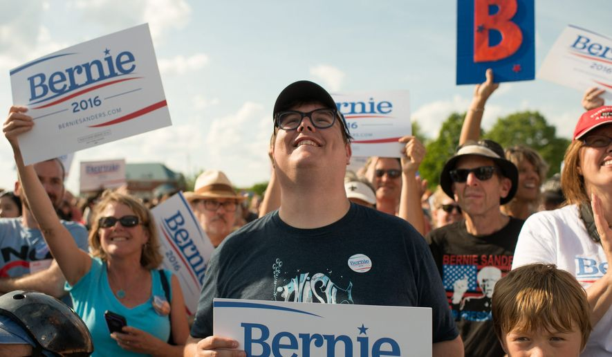 Happy fans cheer while Sen. Bernie Sanders speaks in Burlington, Vermont. (associated press)