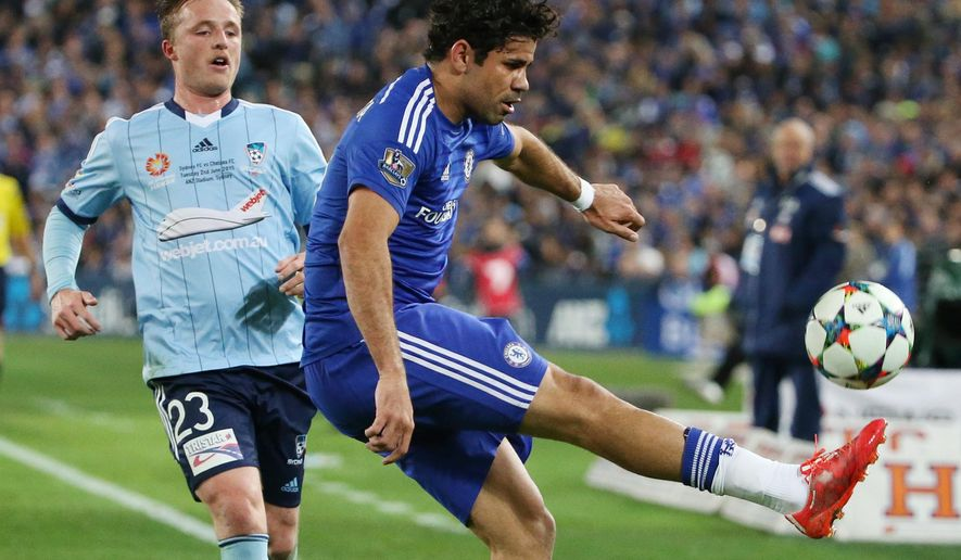 Chelsea's Diego Costa kicks the ball as Sydney FC's Rhyan Grant watches during their friendly soccer match in Sydney, Tuesday, June 2, 2015. (AP Photo/Rick Rycroft)