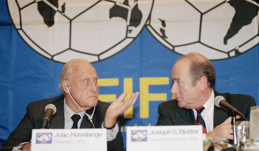 FILE - In this Oct. 27, 1994 file picture Joao Havelange, left, then President of FIFA, and Sepp Blatter, then general secretary, confer during a news conference  in New York. FIFA President Sepp Blatter said Tuesday June 2, 2015, that he will resign from his position amid corruption scandal.  (AP Photo/ L.M. Otero,File)