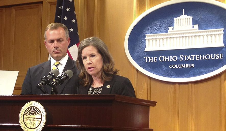 Ohio Reps. Denise Driehaus, right, and Robert Sprague discuss their proposal to give certain immunity to drug users who seek emergency help for someone who has overdosed on heroin or painkillers, at a news conference Tuesday, June 2, 2015, in Columbus, Ohio. The legislation is among several bills expected to be introduced soon to address Ohio's opiate addiction crisis. (AP Photo/Ann Sanner)