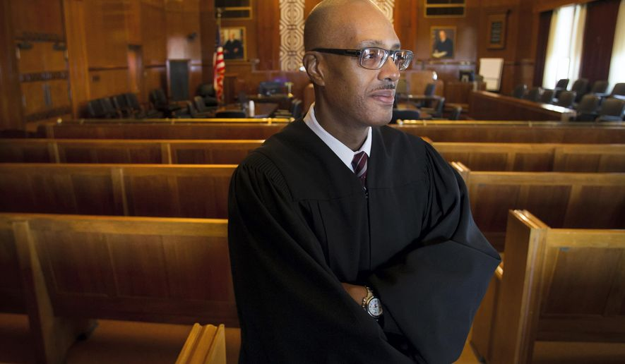 Judge George Hanks, seen in a May 28, 2015 photo, is the new US District Court Judge in Galveston, Texas. He's the first African-American judge to preside over the court and will serve with life tenure. President Barack Obama nominated Hanks in September. Hanks is a Harvard graduate and has been a judge for more than 15 years. (Stuart Villanueva/The Galveston County Daily News via AP)