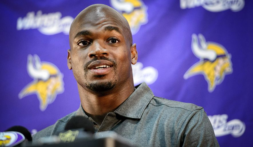 Vikings running back Adrian Peterson speaks at a news conference in Eden Prairie, Minn., Tuesday June 2, 2015.  Peterson practiced with the Vikings for the first time in nine months on Tuesday.   (GLEN STUBBE/Star Tribune via AP)  MANDATORY CREDIT; ST. PAUL PIONEER PRESS OUT; MAGS OUT; TWIN CITIES LOCAL TELEVISION OUT