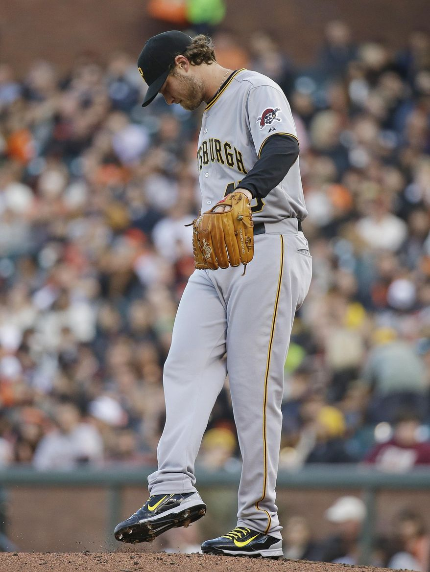 Pittsburgh Pirates starting pitcher Gerrit Cole stands on the mound after loading the bases against the San Francisco Giants in the first inning of their baseball game Monday, June 1, 2015, in San Francisco. (AP Photo/Eric Risberg)
