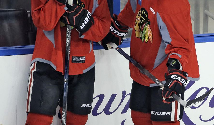 Chicago Blackhawks center Jonathan Toews, left, and center Brad Richards talk during NHL hockey practice at Amalie Arena for the Stanley Cup Finals, Tuesday, June 2, 2015, in Tampa, Fla. The Blackhawks take on the Tampa Bay Lightning in Game 1 on Wednesday.  (AP Photo/Chris O'Meara)