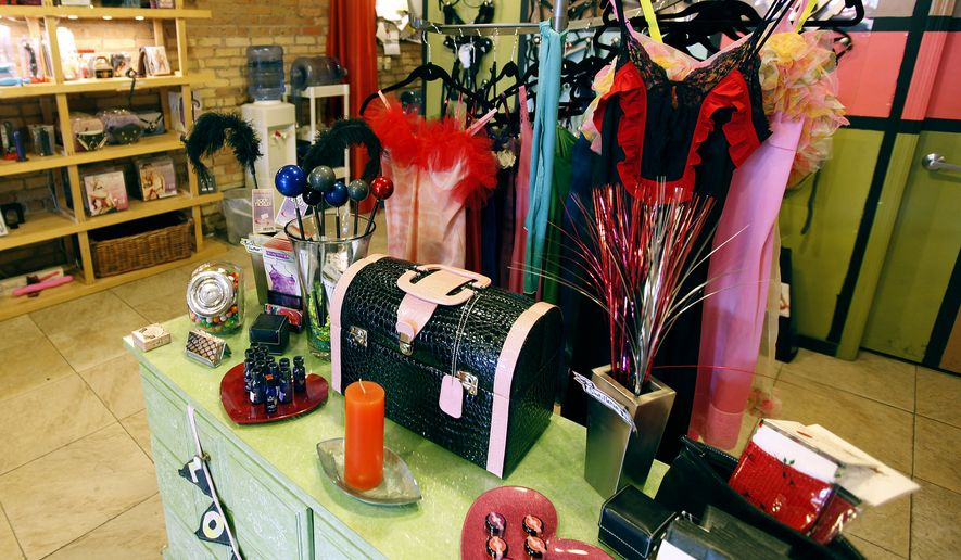 In this 2010 photo, merchandise appears on display at adult novelty store Smitten Kitten in Minneapolis. Gaia Democratic School director Starri Hedges has drawn the ire of parents after taking students on a field trip to the store. Ms. Hedges told the Star Tribune that she wanted to provide a safe environment for students to learn about human sexual behavior. Besides offering adult books, videos, toys and other products, the store also has educational workshops, which the students attended. (Jerry Holt/Star Tribune via AP)