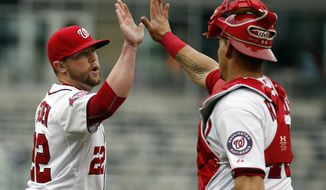 Washington Nationals relief pitcher Drew Storen (22) and catcher Wilson Ramos (40) celebrate after their 2-0 win over the Toronto Blue Jays in the first baseball game of a doubleheader at Nationals Park, Tuesday, June 2, 2015, in Washington.  (AP Photo/Alex Brandon)